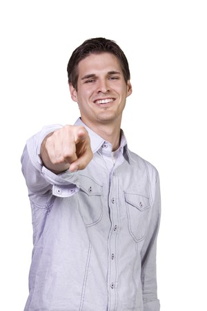 pointing finger: Isolated Young man smiling and  pointing finger
