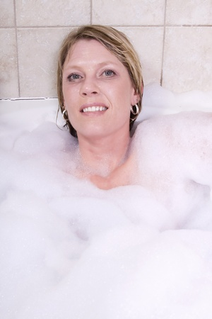 Close up on a Woman in the Tub Bathing photo
