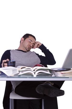 College Student Falling Asleep while Studying for his Finals - Isolated Background Stock Photo - 8588405