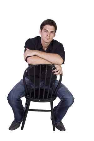 Handsome and stylish model sitting on chair - Isolated photo
