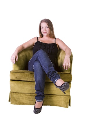 woman on couch: Woman sitting on a chair with white background