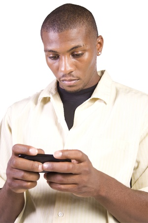 strong message: Isolated casual black man texting on his cell phone