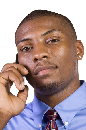 Isolated Black businessman with his hand in pocket talking on the phone photo