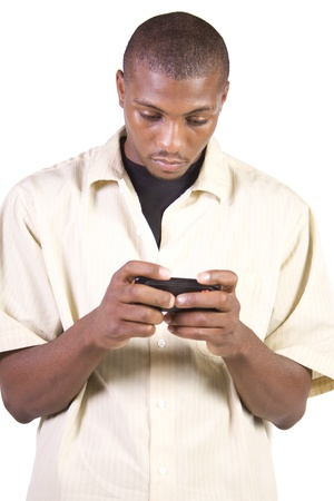 Isolated casual black man texting on his cell phone