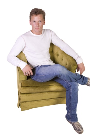 comfortable chair: white man sitting on chair relaxed-white background Stock Photo