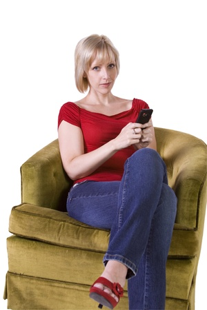 Beautiful Woman texting on the couch at home photo