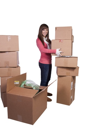 young girl packing up and moving - white background Stock Photo - 8765781