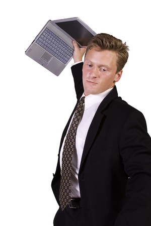 Frustrated Businessman Throwing His Laptop - Isolated Background photo
