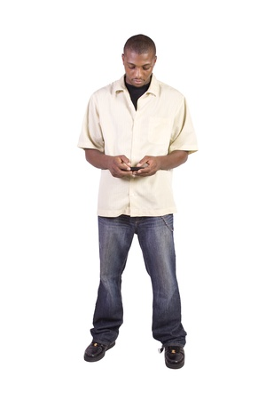 Isolated casual black man texting on his cell phone photo