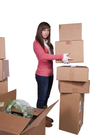 young girl packing up and moving - white background Stock Photo - 9740931