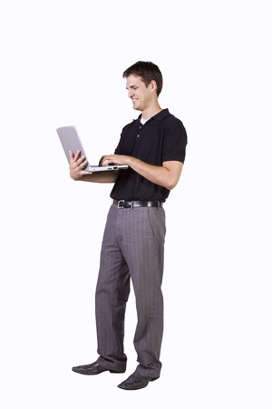 working: Isoalted Young Businessman working on laptop while standing up