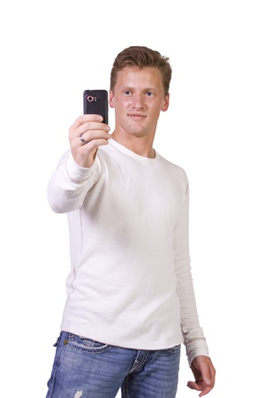 Isolated businessman sending a picture message on his cell phone photo