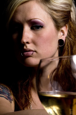 Close up on a Woman with Wine - Black Background photo