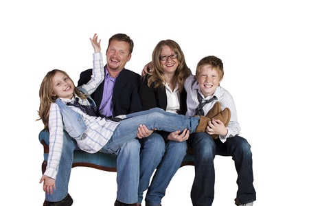 Isolated image of a cute family posing - white background photo