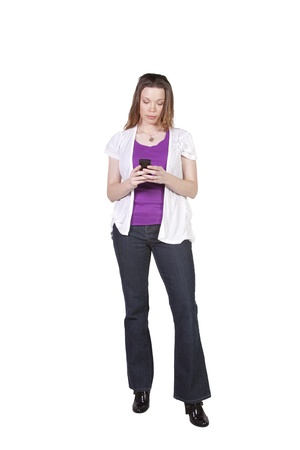 Beautiful Girl Texting on an Isolated Bacground Reklamní fotografie - 10815141