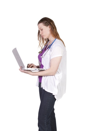 Isolated Shot - Beautiful Female Doctor Holding a Laptop photo