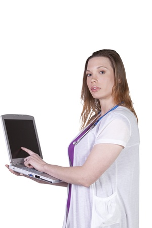 Isolated Shot - Beautiful Female Doctor Holding a Laptop 免版税图像