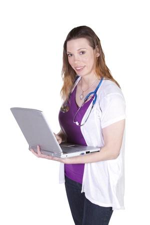 Isolated Shot - Beautiful Female Doctor Holding a Laptop photo