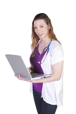 Isolated Shot - Beautiful Female Doctor Holding a Laptop Stock Photo