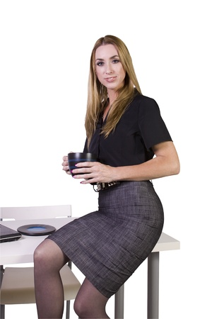Beautiful Sexy Woman Sitting on the Desk at Work Stock Photo - 11777529