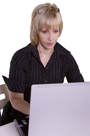 Isolated Businesswoman working on her laptop in the Office photo