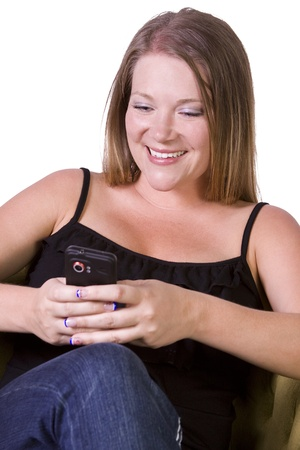 Beautiful Woman texting on the couch at home Stock Photo - 11777799