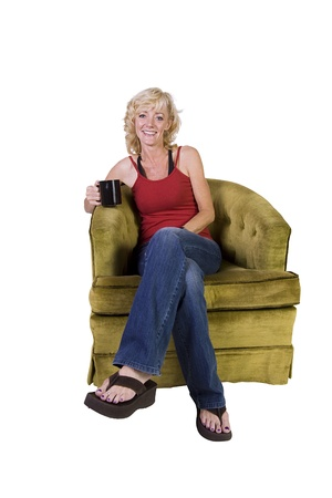 Woman sitting on a chair with white background Stock Photo - 12873954