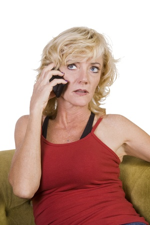 Woman talking on her cell phone at home- Isolated Background photo
