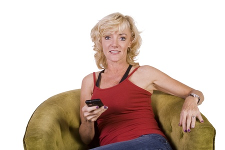 Beautiful Woman texting on the couch at home