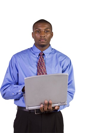 Isoalted Young black Businessman working on laptop while standing up photo