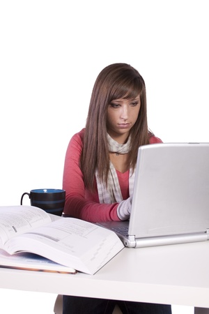 Young high school student studying for exams photo