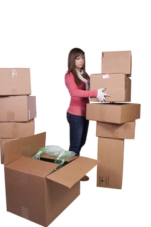 young girl packing up and moving - white background photo