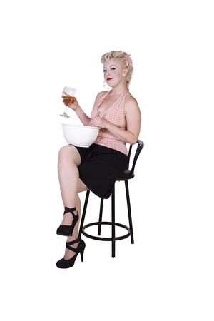 Sexy Retro Woman Drinking Wine while Cooking - Isolated Background photo