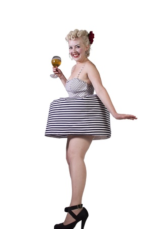 Beautiful pinup retro girl with wine enjoying cool air from fan - Isolated White Background photo