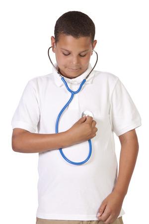 cute teen boy: Cute teen boy using a stethescope on himself