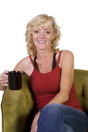 Woman sitting on a chair with white background photo