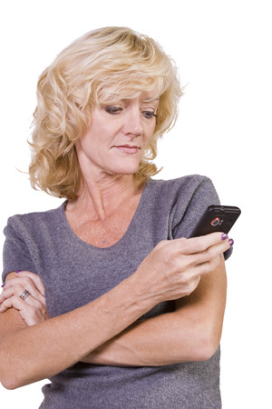 Beautiful Girl Texting on an Isolated Bacground Stock Photo - 29434588
