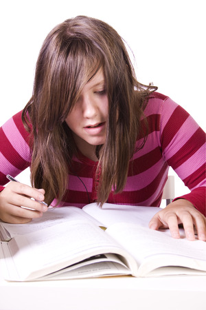 collegian: Young high school student studying for exams