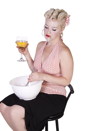 Sexy Retro Woman Drinking Wine and Smoking while Cooking - Isolated Background photo