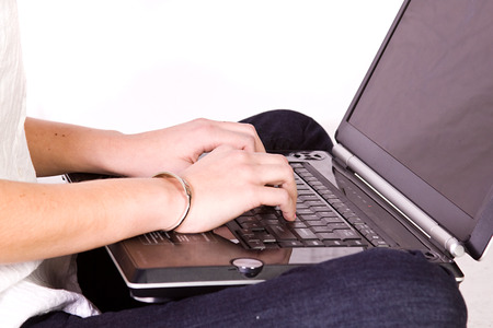 Close up on a Girl's Hand Typing on the Laptop photo