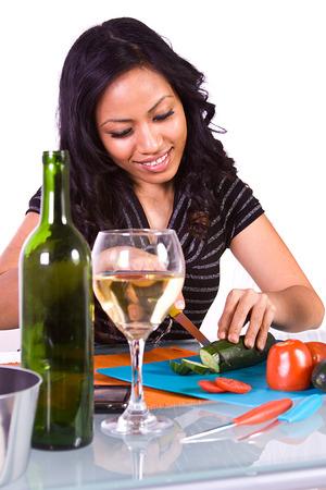 Beautiful Girl Preparing Food and Drinking Wine photo