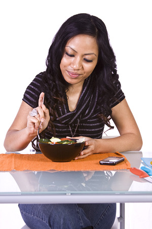 Beautiful Girl Eating Salad - Isolated Close up photo