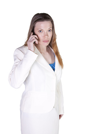 Isolated Businesswoman at Talking on the Cell Phone at Work photo