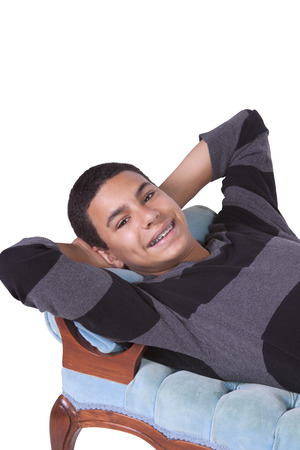 preteen boys: Cure Preteen Boy on the Couch - Isolated Background