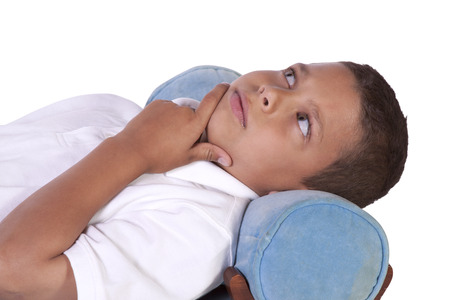 preteen boy: Cure Preteen Boy on the Couch - Isolated Background