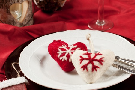 Red, romantic place setting for christmas or celebration wit white and red heart Stock Photo - 11195152