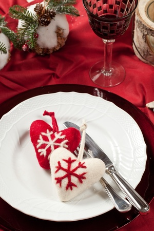 Red, romantic place setting for christmas or celebration wit white and red heart photo