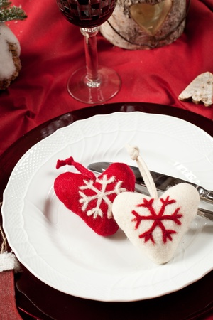 Red, romantic place setting for christmas or celebration wit white and red heart Stock Photo - 11195155