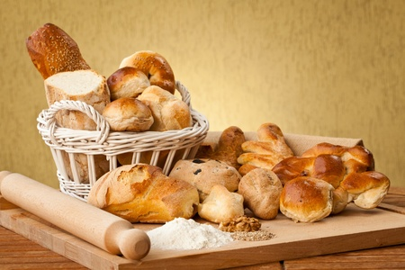 loaves: Basket of different types of gourmet brerad with flour, sesame seeds and nuts