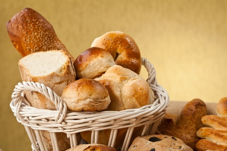 bread basket: Basket of different types of gourmet brerad with flour, sesame seeds and nuts